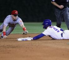 Votto's historic streak comes to an end with Cubs walk-off dash