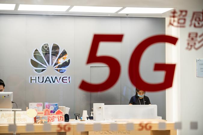 SHENZHEN, CHINA - 2020/10/05: Chinese multinational technology company Huawei logo and 5G sign seen at a store. (Photo by Alex Tai/SOPA Images/LightRocket via Getty Images)