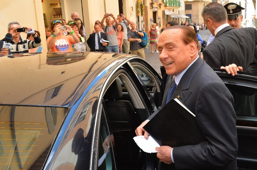 Italians voted Sunday in regional elections seen as a key measure of the fading fortunes of ex-premier Silvio Berlusconi (AFP Photo/Andreas Solaro)