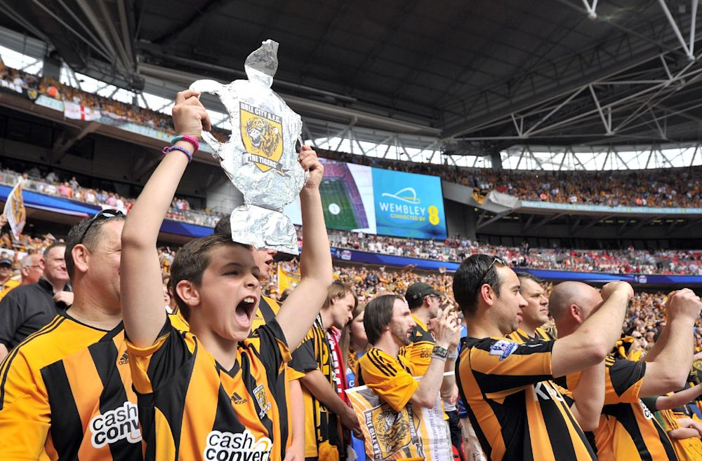 Hull City fans cheer before the start of the English FA Cup final match between Arsenal and Hull City at Wembly Stadium in London on May 17, 2014