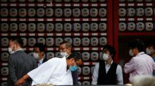 Tokyo declares coronavirus red alert as situation 'rather severe'
