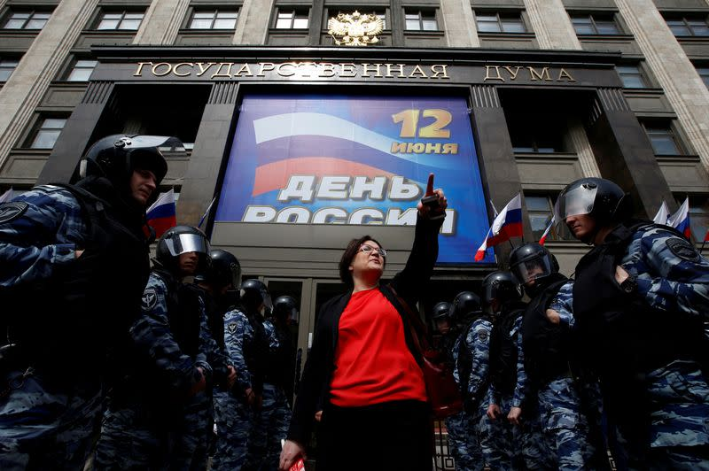 FILE PHOTO: Activist Galyamina is surrounded by police during a picket against a renovation law under the Moscow government's renovation plan in front of the State Duma in Moscow