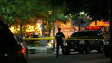 Gunman kills two, injures 12 on Toronto street, police say