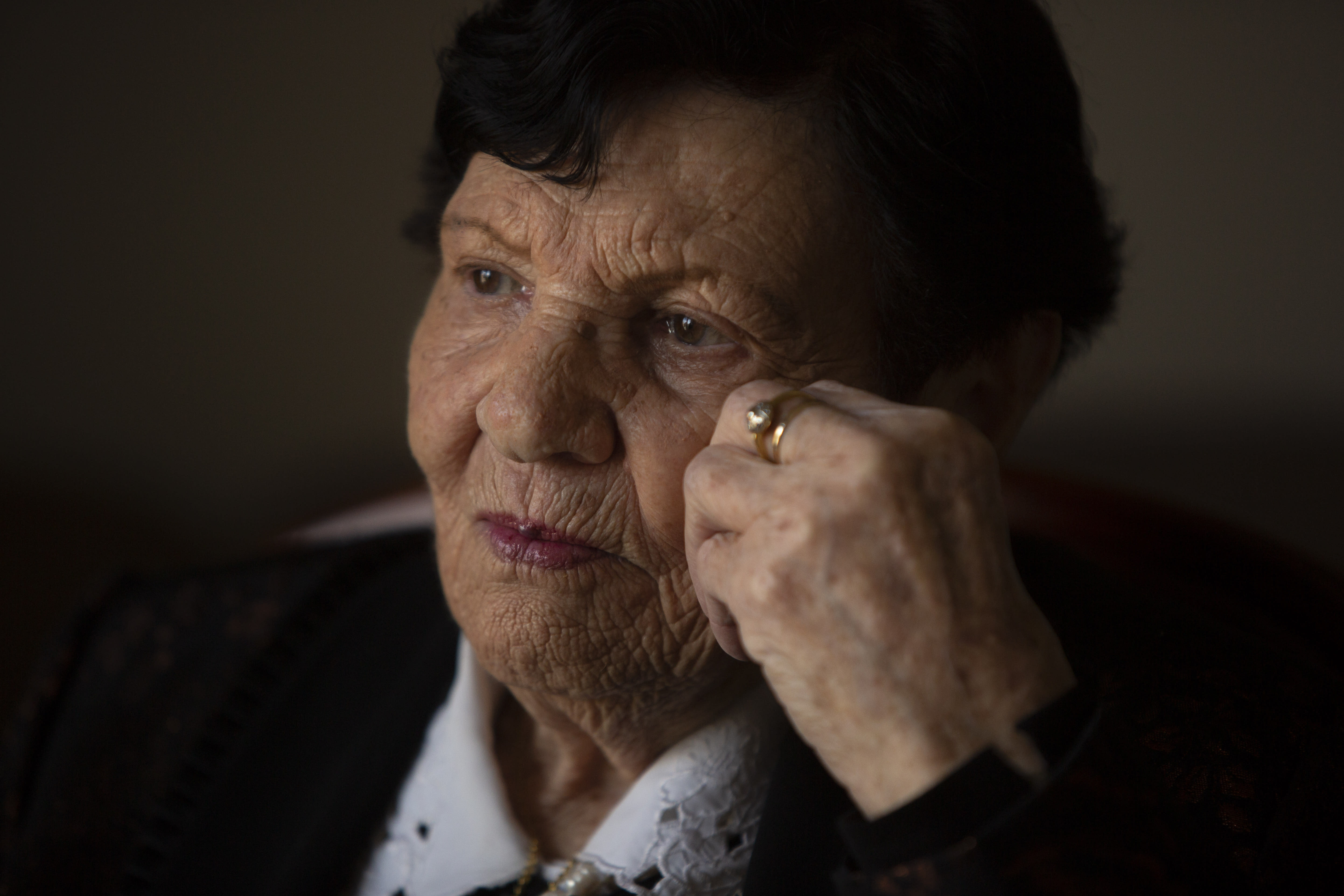 In this Wednesday, Jan. 23, 2019 photo, Holocaust survivor Cipora Feivlovich gives an interview to The Associated Press at her house in Jerusalem. As the world commemorates the anniversary of the liberation of Auschwitz on International Holocaust Remembrance Day, death camp survivor Feivlovich marks her own personal milestone as she turns 92. She's spent her most recent birthdays recounting to audiences in Israel and Germany her harrowing experiences in the infamous camp, where her parents, brother and best friends all perished. (AP Photo/Sebastian Scheiner)