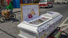 Open coffins are left on roads to remind people to stay inside while soldiers shoot disinfectant from water cannons. Here's what lockdown for 57 million people in the Philippines looks like.