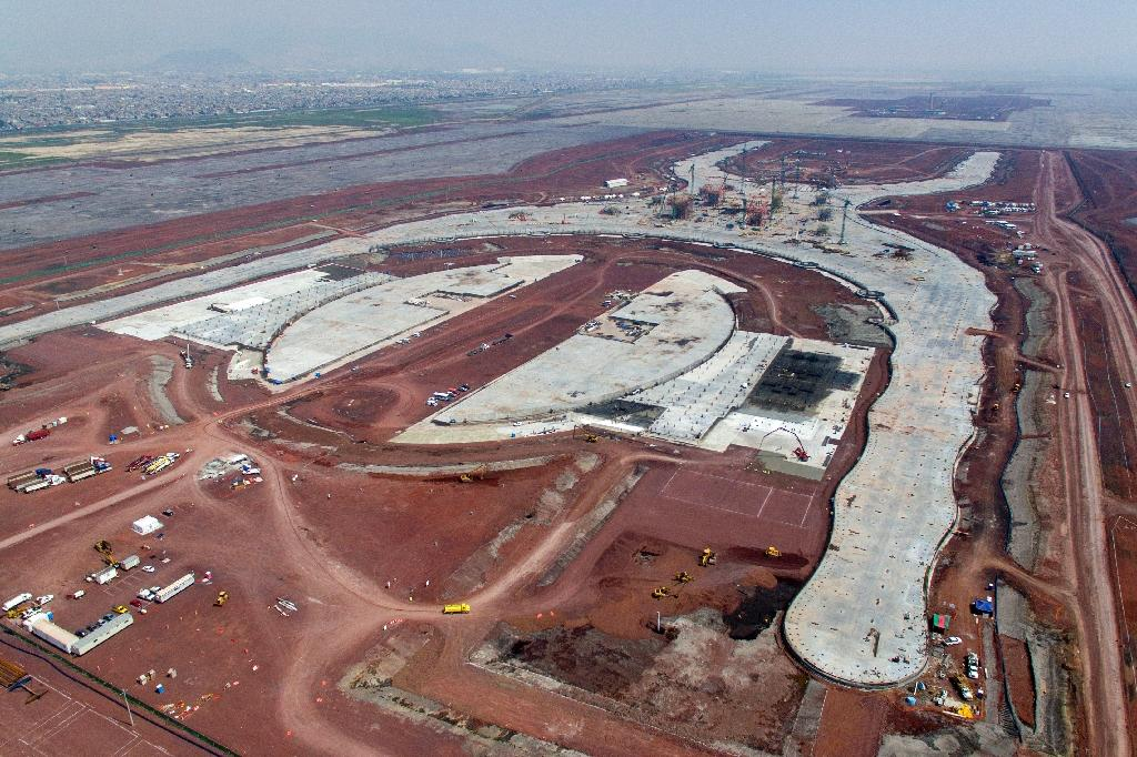 Fitch said president-elect Andres Manuel Lopez Obrador's decision to cancel Mexico City's new airport, pictured under construction in July, sends a negative signal to investors (AFP Photo/Pedro PARDO)