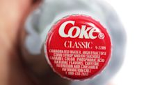 Coke beating earnings raises revenue forecast for the beverage company