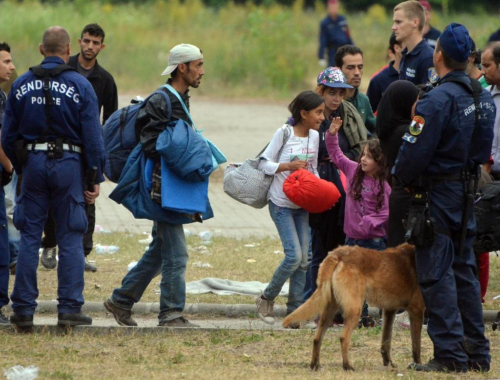 Hungary says it is sending an additional 2,100 officers to the Serbian border to deal with the influx of migrants (AFP Photo/Csaba Segesvari )