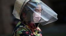 Coronavirus infects hundreds in China's prisons as global markets take hit