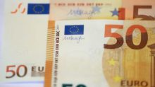 Euro holds below two-week high before survey data; Aussie falls