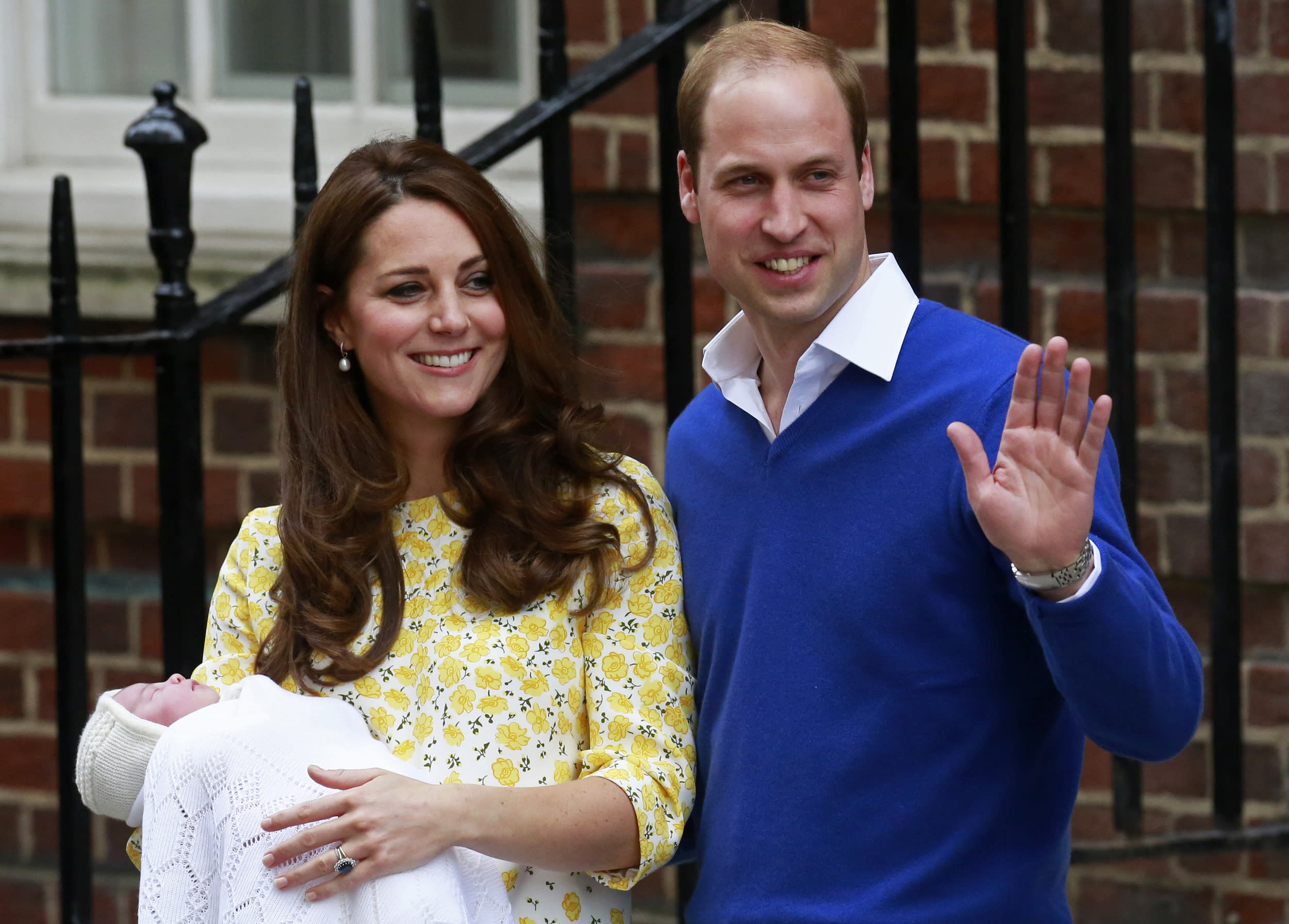 Britain's Prince William and his wife Catherine, Duchess of Cambridge, appear with their baby daughter, Charlotte Elizabeth Diana, outside the Lindo Wing of St Mary's Hospital, in London, Britain May 2, 2015. The Duchess of Cambridge, gave birth to a girl on Saturday, the couple's second child and a sister to one-year-old Prince George.      REUTERS/Cathal McNaughton