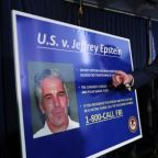 Jeffrey Epstein: prison guards charged with hiding failure to keep watch
