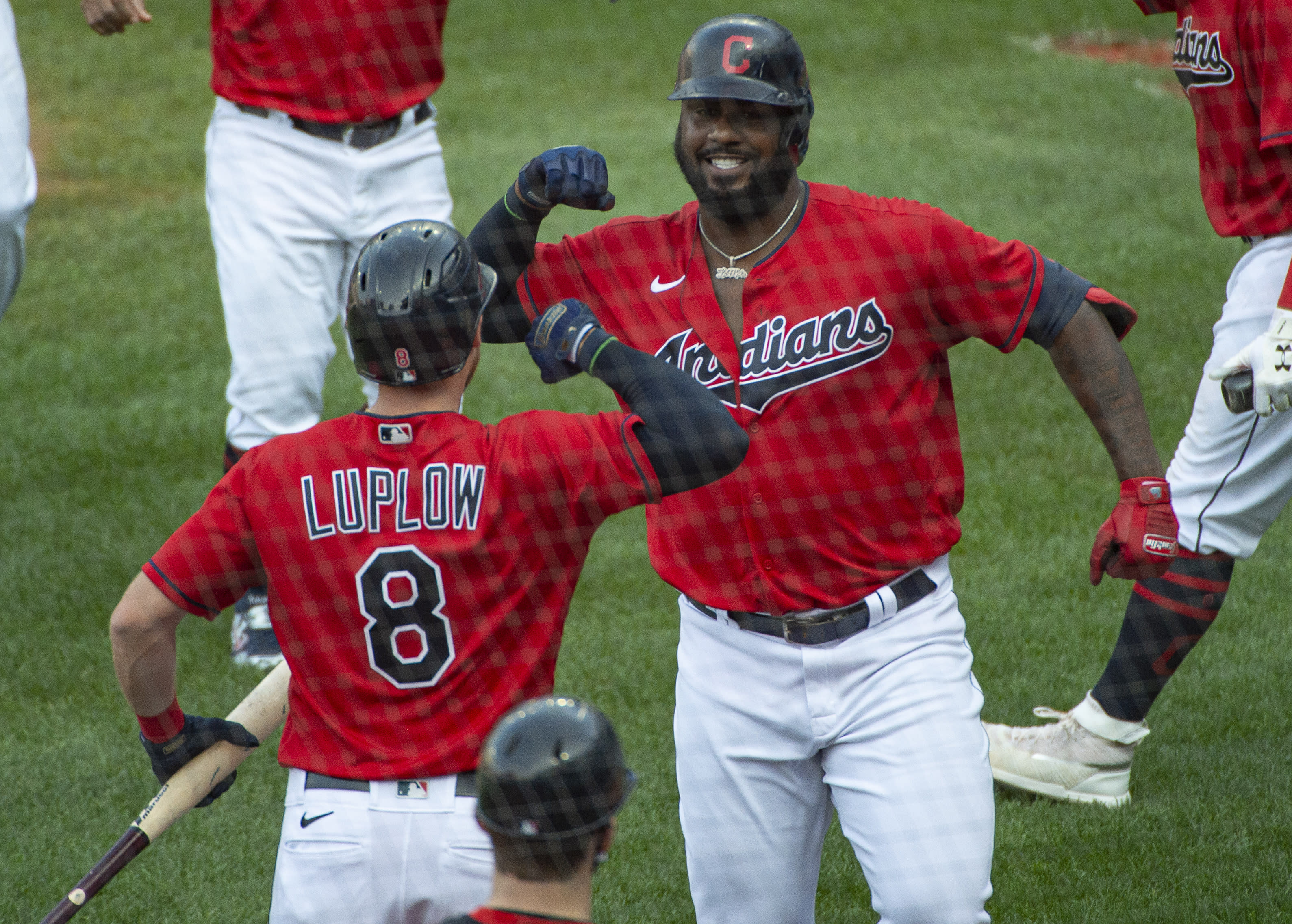 Cleveland Indians' Franmil Reyes, right, celebrates with Jordan Luplow (8) after hitting a three-run home run off Pittsburgh Pirates relief pitcher Geoff Hartlieb during the sixth inning of a baseball game in Cleveland, Sunday, Sept. 27, 2020. (AP Photo/Phil Long)