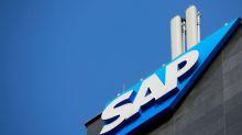 SAP, gaining market share, raises outlook