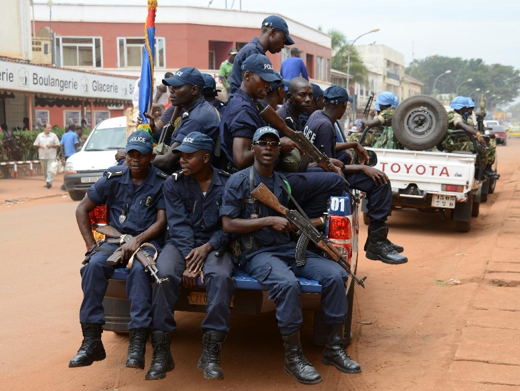 Central African Republic police forces patrol along with UN MINUSCA peacekeepers in the capital Bangui on October 3, 2014
