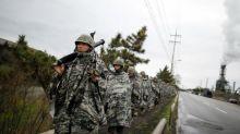 US and South Korea to suspend war games following summit between Donald Trump and Kim Jong-un