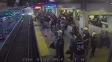 Railway worker pulls passenger to safety