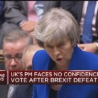 UK Prime Minister Theresa May speaks after surviving no-c...
