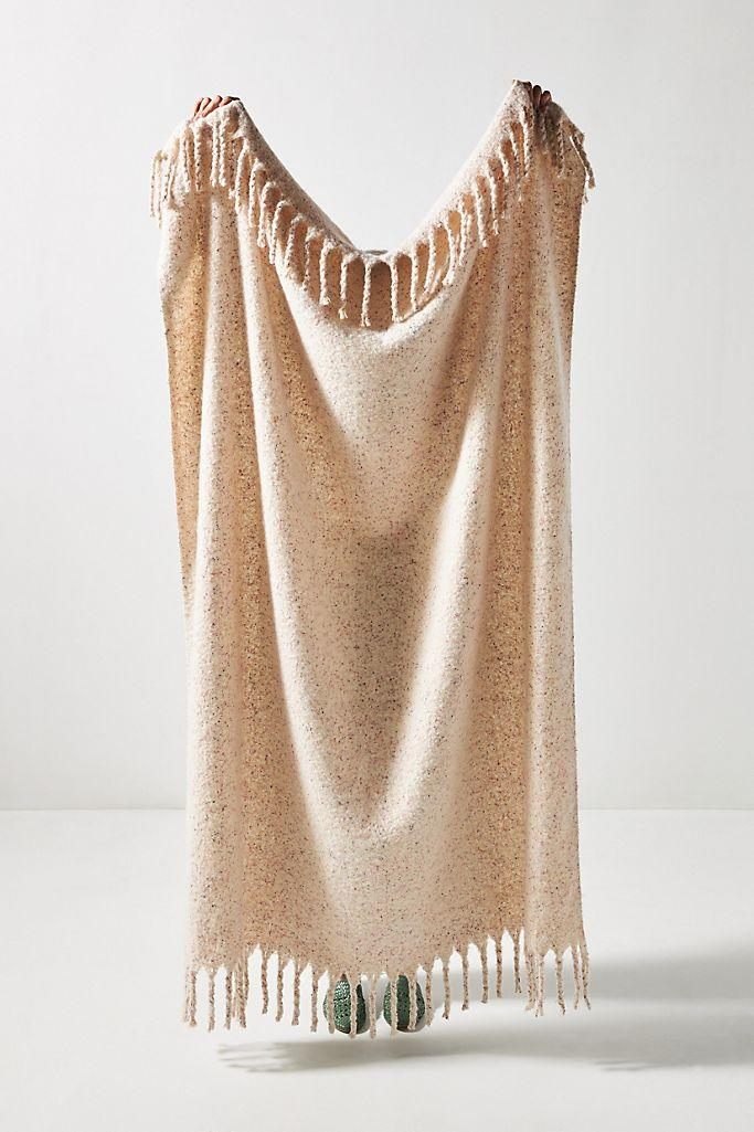 """A Funfetti lover's delight. Not only does this poly cotton throw from Anthropologie look ultra soft, but it's also got a subtle sprinkling of color care of the confetti print. The braided tassels also give it an extra cozy vibe. $78, Anthropologie. <a href=""""https://www.anthropologie.com/shop/confetti-throw-blanket"""" rel=""""nofollow noopener"""" target=""""_blank"""" data-ylk=""""slk:Get it now!"""" class=""""link rapid-noclick-resp"""">Get it now!</a>"""