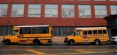 Buses are parked outside a school in Brooklyn. (Reuters)