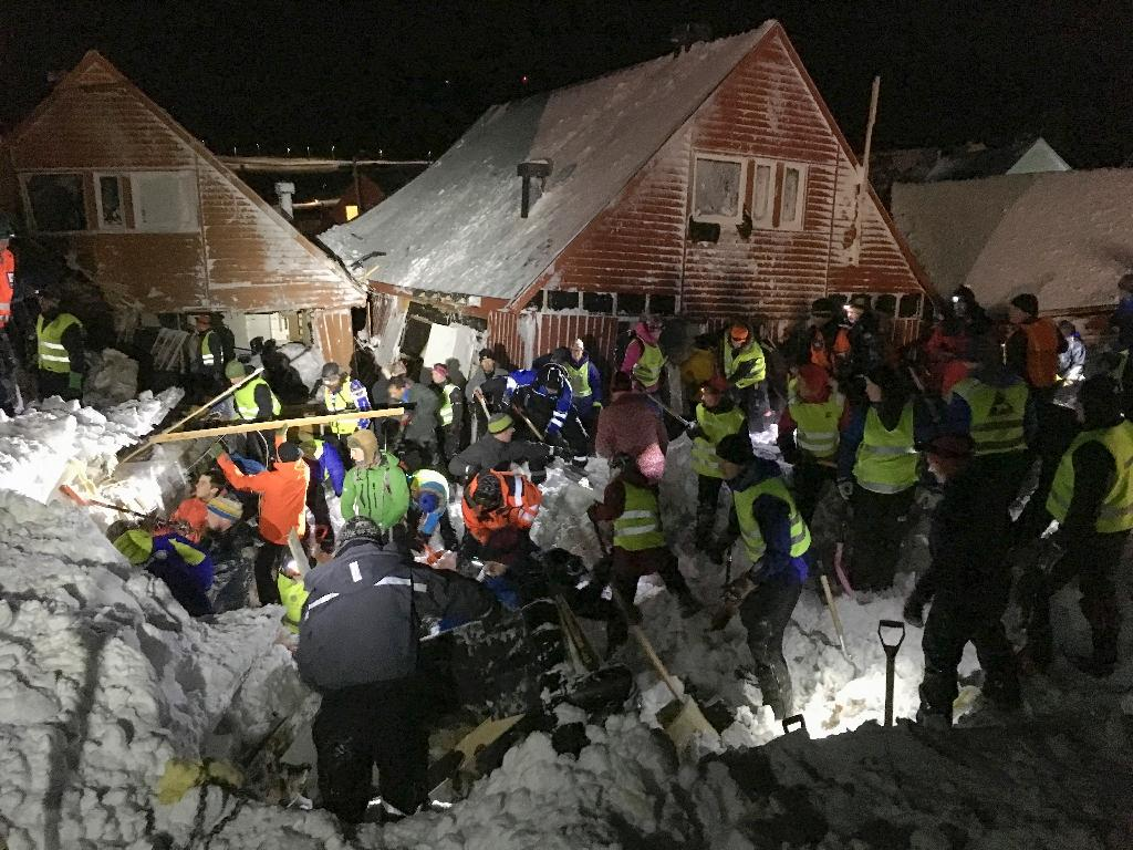Search crews work in the area where an avalanche has hit several houses in Longyearbyen, Norway on December 19, 2015