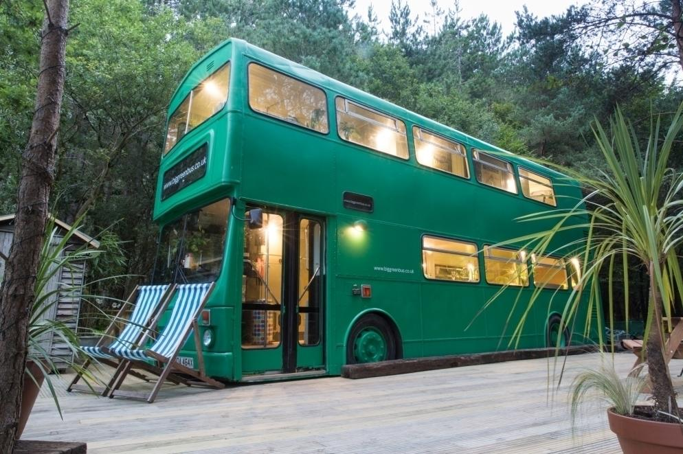"""This fabulous converted bus in the heart of the Sussex countryside is the stuff of dreams for kids. It features a log burner in the living room, a kitchen and three bedrooms that sleep six. Outside the <a href=""""http://www.coolstays.com/property/big-green-bus/17544"""" target=""""_blank"""">Big Green Bus</a>, you can make use of a wood-fired hot tub and a fire pit, with plenty of space to explore the wood that surrounds you. The whole family will adore exploring the woodland, enjoying the Big Green Bus' famous chill on the fire put and trips to nearby pubs. From £175 per night."""