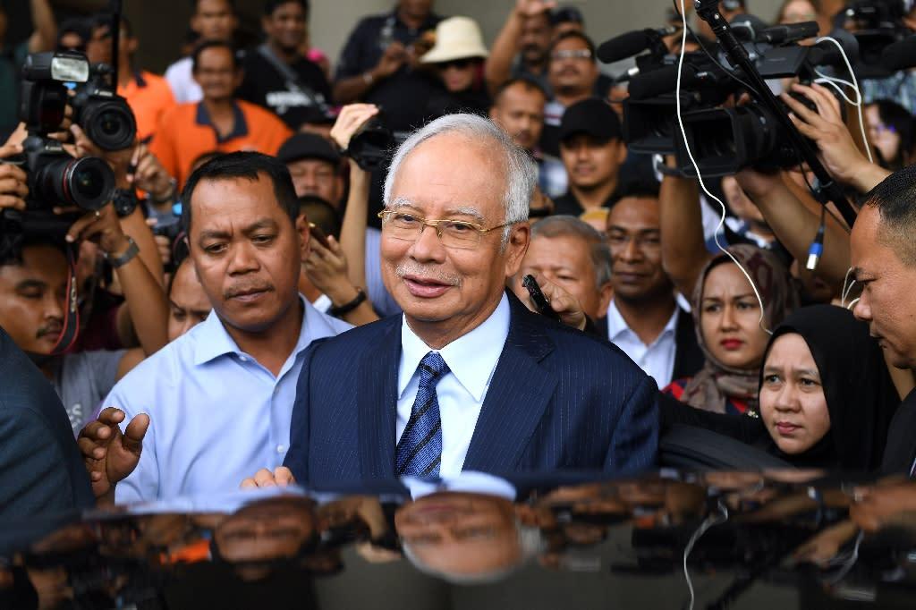 Former PR guru Paul Stadlen was known for staunchly defending Najib Razak (C) even as corruption allegations against him multiplied
