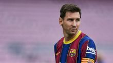 Lionel Messi reportedly re-signs with Barcelona at lower salary