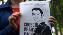 Supporters detained as Russia charges ex-reporter with treason