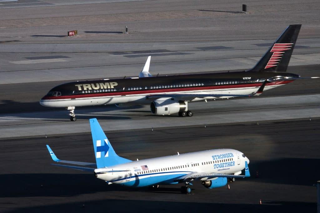 Republican presidential nominee Donald Trump's plane passes Democratic presidential nominee Hillary Clinton's campaign plane at McCarran International Airport, in Nevada, on October 18, 2016 (AFP Photo/Brendan Smialowski)