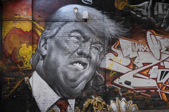 Street art mural of a grimmacing former US President Donald Trump in Digbeth on 31st March 2021 in Birmingham, United Kingdom. Trump and the image of him has been the subject of much derision both during and after his presidency, and to some becoming a figure of hate, who has been heavily satirised and mocked. (photo by Mike Kemp/In Pictures via Getty Images)
