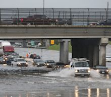 Stranded cars, rescues and deadly flooding: Waters slowly begin receding in Houston after Imelda
