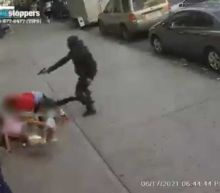 Shocking footage shows a gunman repeatedly shoot at a man while two children frantically dodge his bullets on a New York City sidewalk