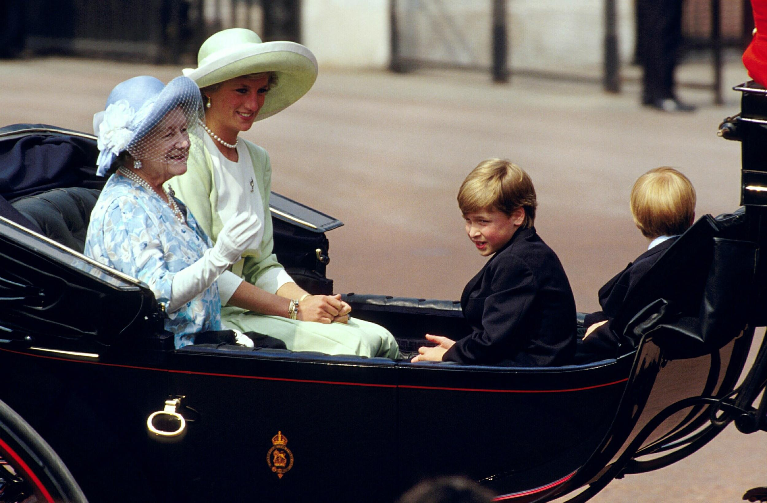 LONDON - JUNE 16:  (FILE PHOTO) (PRINCESS DIANA RETROSPECTIVE 22 OF 22)  The Queen Mother, the Princess of Wales and her children, Prince William and Prince Harry, ride back to Buckingham Palace during the ceremonies of the Trooping of the Colour June 16, 1990 in London, England. Princess Diana, 36-years-old, died with her companion Dodi Fayed, 41-years-old, in a car crash August 31, 1997 in Paris, France. Fayed was the son of an Egyptian billionaire.  (Photo by Georges De Keerle/Getty Images)