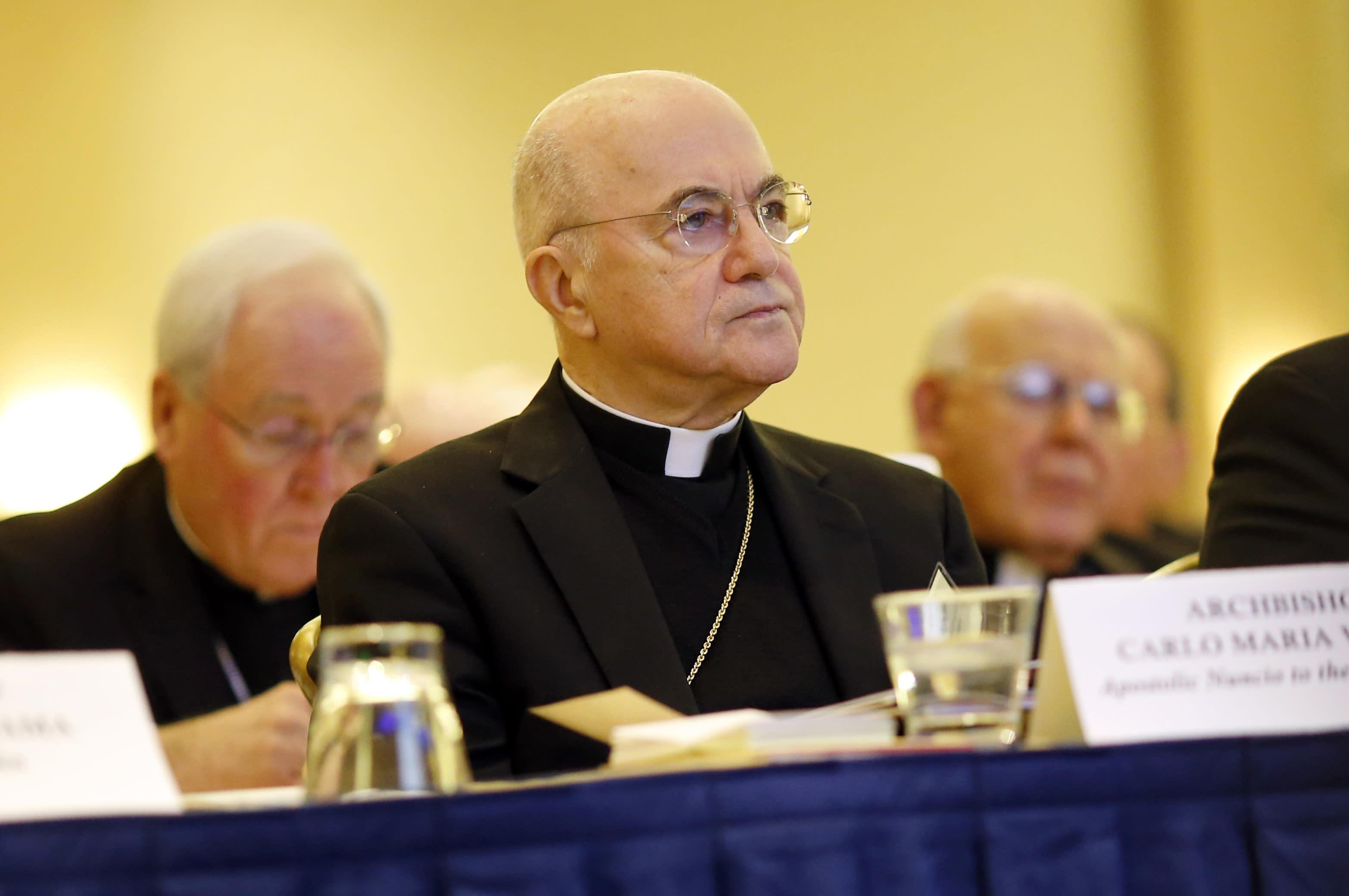 FILE - In this Nov. 16, 2015 file photo, Archbishop Carlo Maria Vigano, Apostolic Nuncio to the U.S., listens to remarks at the U.S. Conference of Catholic Bishops' annual fall meeting in Baltimore. Vigano accused Pope Francis last month of covering up the sexual misconduct of ex-Cardinal Theodore McCarrick and rehabilitating him from sanctions imposed by Pope Benedict XVI. (AP Photo/Patrick Semansky, File)
