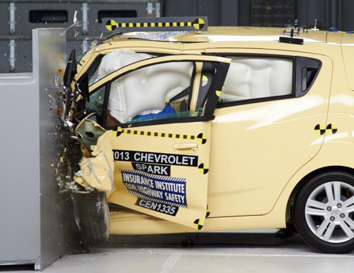 This undated photo provided by the Insurance Institute for Highway Safety shows the Chevrolet Spark during a crash test. The Spark is the only minicar tested to earn an acceptable rating in the small overlap front test. (AP Photo/Insurance Institute for Highway Safety)