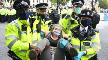 Police arrest 90 people as Extinction Rebellion protesters swarm central London