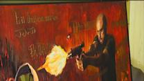 Graphic painting of Zimmerman shooting Martin unveiled at Florida capitol