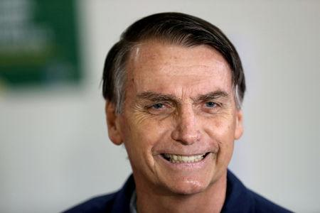 FILE PHOTO: Jair Bolsonaro, far-right lawmaker and presidential candidate of the Social Liberal Party (PSL), casts his vote in Rio de Janeiro