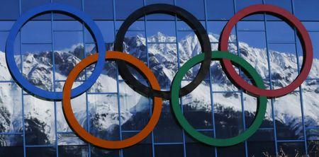 Snow covered mountains are reflected in the walls of the Olympic ice hockey stadium of Innsbruck