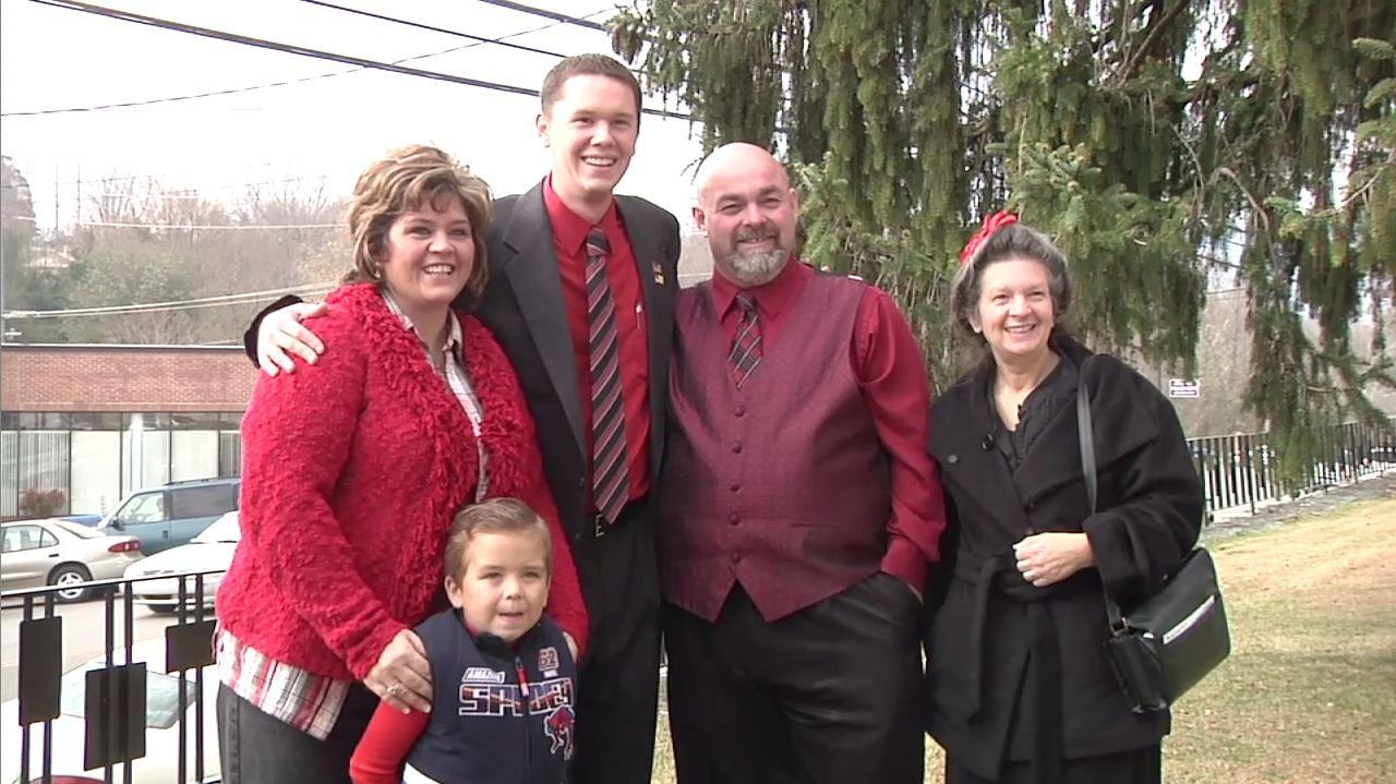 """In this image made from a video provided by WATE, shows Jamie Coots, second from right, a pastor who appeared on the National Geographic television reality show """"Snake Salvation,"""" posing with Pastor Andrew Hamblin, third from right, and others, in Knoxville, Tenn. Coots died Sunday, Feb. 16, 2014, after being bitten by a snake. (AP PHOTO/WATE, Jill McNeal)"""
