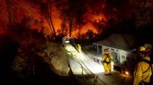 Evacuated California residents make cautious return home as deadly wildfires keep raging