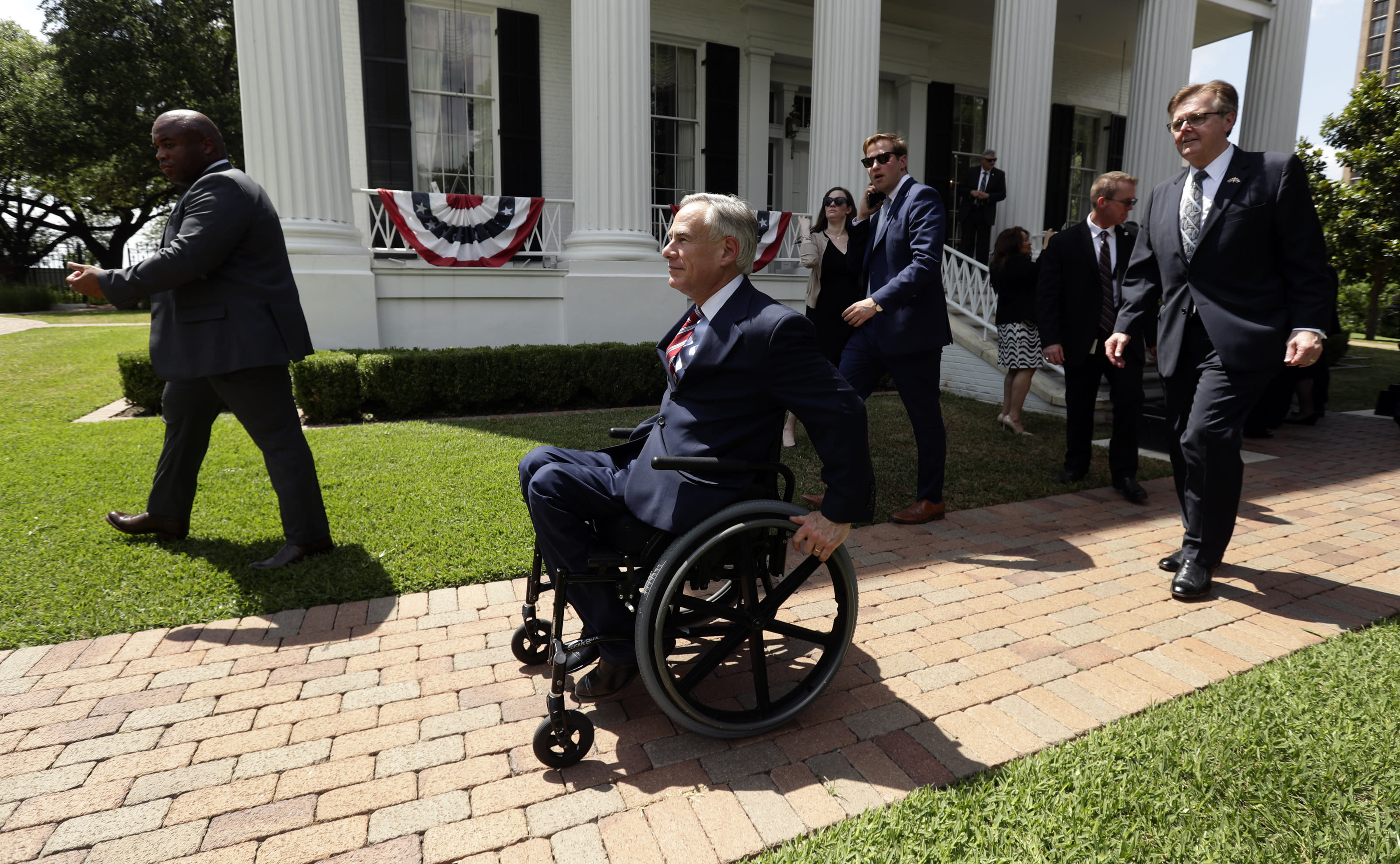 Governor Greg Abbott is followed by Lt. Governor Dan Patrick after a joint press conference to announce changes to teacher pay and school finance at the Texas Governor's Mansion in Austin, Texas, Thursday, May 23, 2019, in Austin. (AP Photo/Eric Gay)