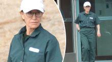 Felicity Huffman looks downcast in her prison greens