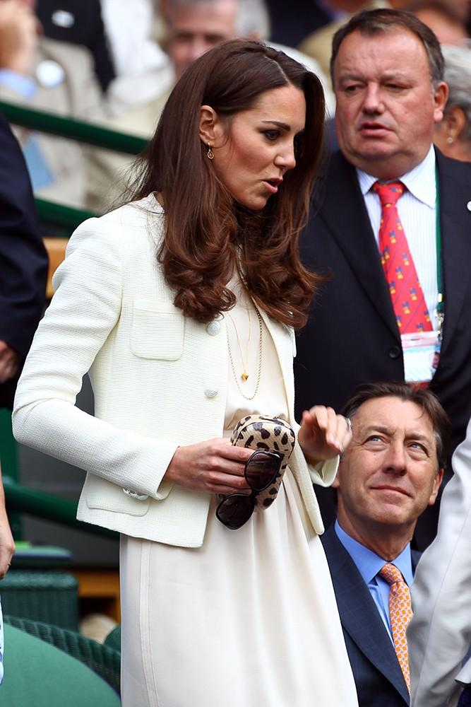 Kate looked chic in white at Wimbledon, carrying a fun animal print clutch.