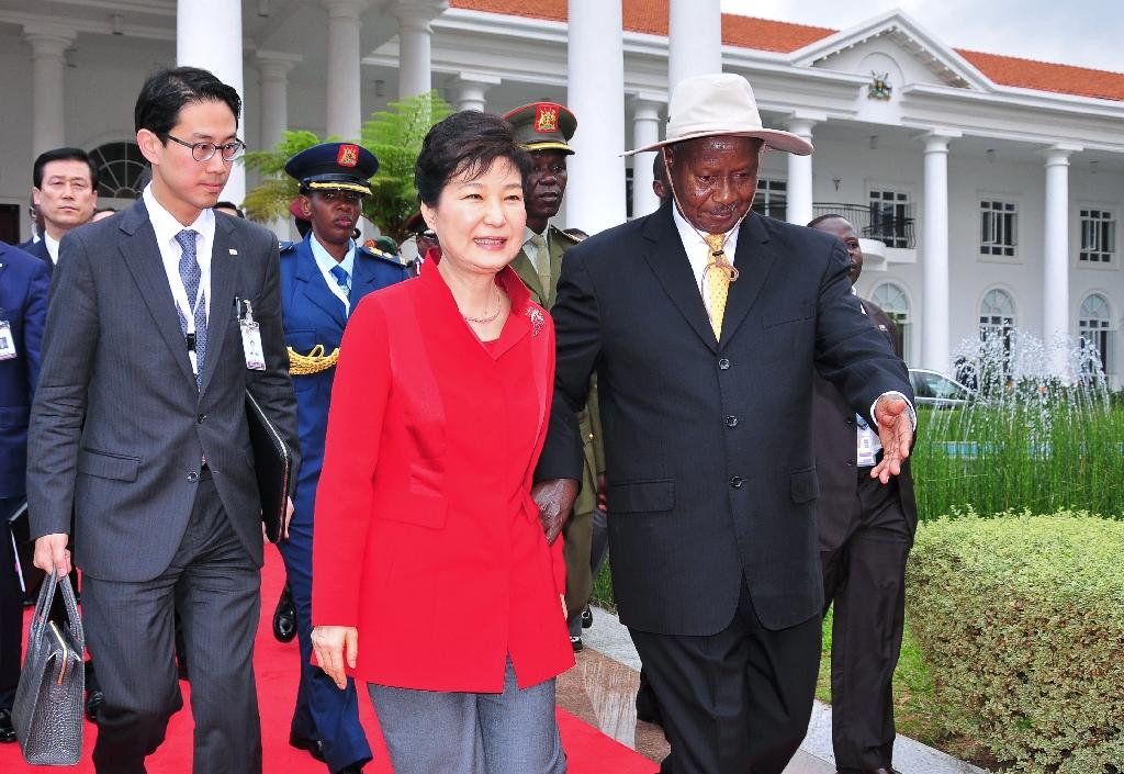 "During a summit with visiting South Korean President Park Geun-Hye (C), Uganda's President Yoweri Museveni (R) said he had ordered officials ""faithfully"" to honour the latest UN sanctions, a Seoul official said"