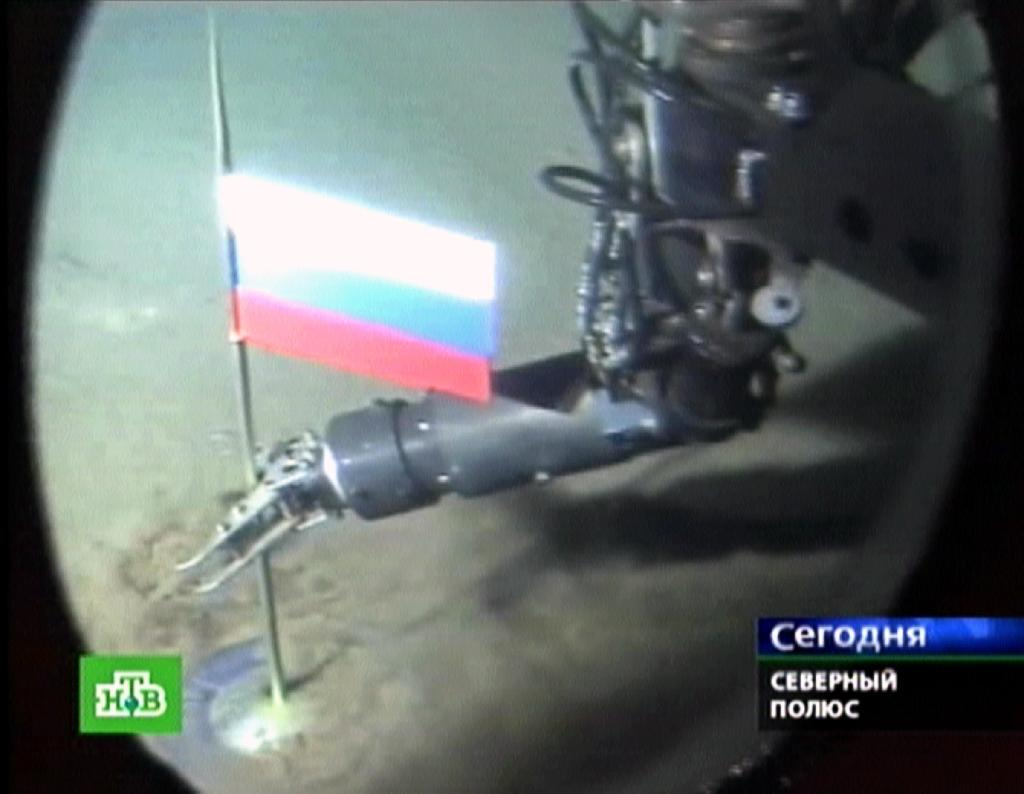 A Russian NTV channel grab shows a manipulator of the Mir-1 mini-submarine as it places a Russian state flag at the seabed of Arctic ocean at a depth of 4,261 meters (13,980 feet)