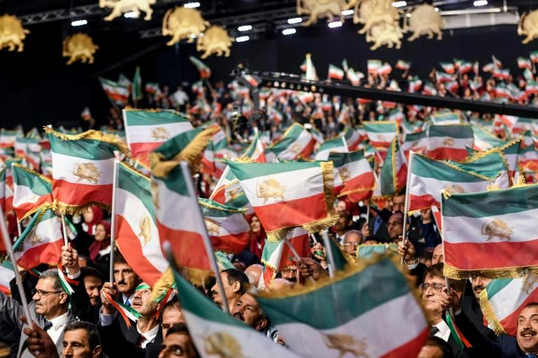 Supporters of the Mujahedin-e Khalq or People's Mojahedin Organization of Iran (MEK) wave Iranian flags at a July 2019 event in Manza, Albania