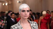 Cara Delevingne Paints Her Shaved Head Silver for the Met Gala