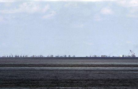 The alleged on-going land reclamation of China at Subi reef is seen from Pagasa island (Thitu Island) in the Spratlys group of islands in the South China Sea